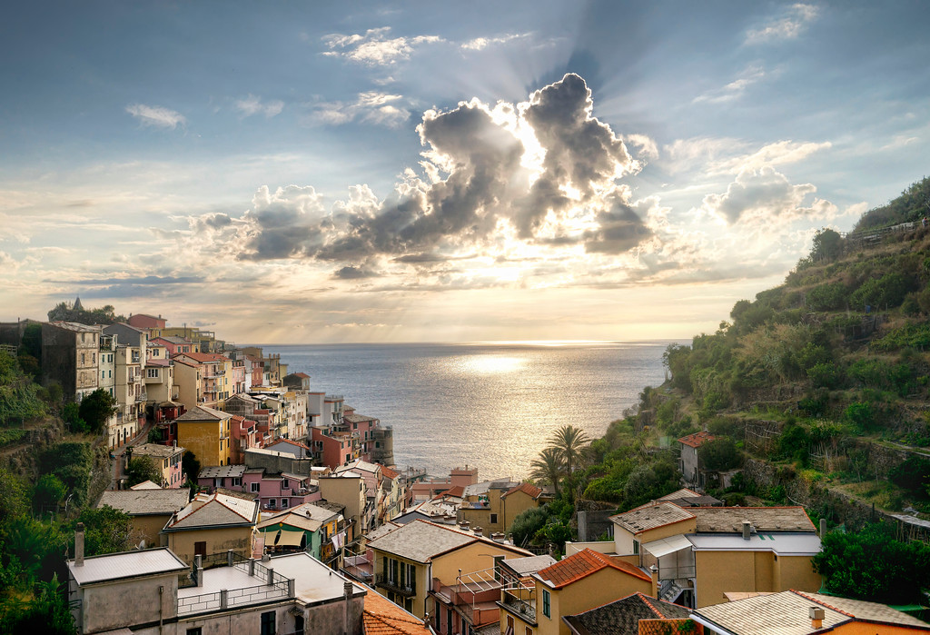 manarola sunset village and ocean cloud