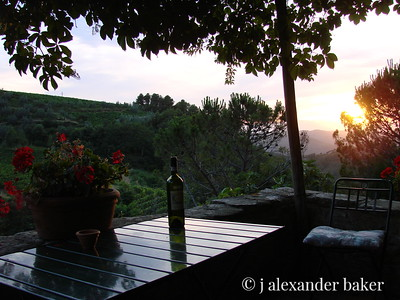 A perfect sunset in Tuscany and an empty bottle of Lamole di Lamole, an excellent local Chianti.