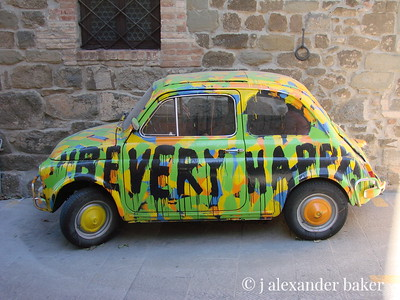 Be Very Happy - coming upon this little Fiat in the medieval Tuscan village of  Montalcino really does put a smile on your face on a hot day.