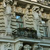 Notice the muscular men balancing stacks of Corinthian columns on their shouders<br /> Apartment building with shops (1901) located at Elizabetes iela 33<br /> -Riga, Latvia