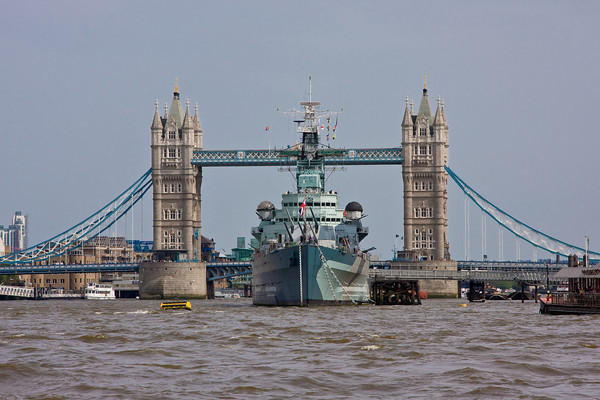 HMS Belfast and the Tower Bridge from the Thames River, London, England