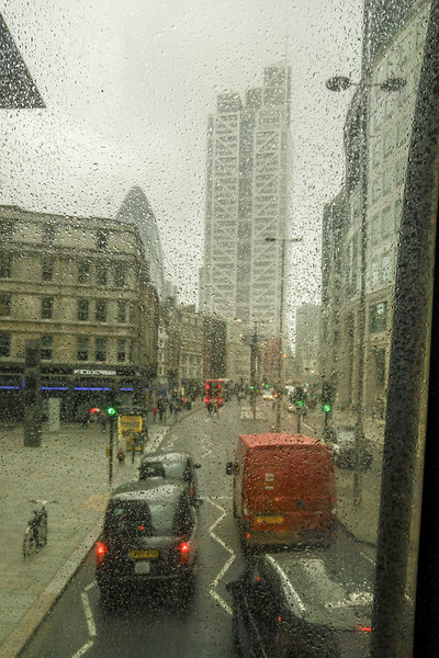 Rainy day view from a double decker bus in London