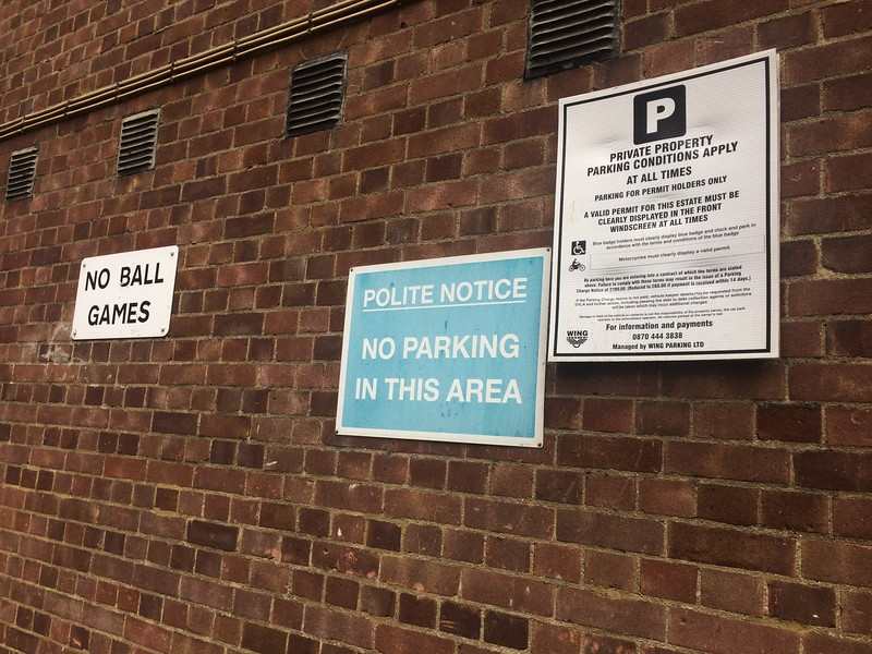 """Would you please, please, very kindly NOT PARK HERE!"" Could you imagine a U.S. sign with a ""Polite Notice""? And what's up with ""No ball games""??"