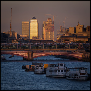 Canary Wharf at sunset from Waterloo Bridge