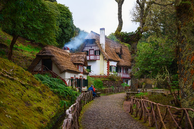 Historic house with thatched roof in Queimadas Forest Park, Madeira, Portugal