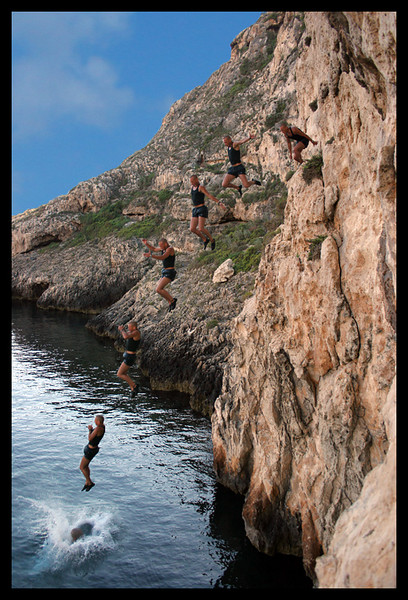 A picture of Paul jumping off a cliff in Xlendi Bay.