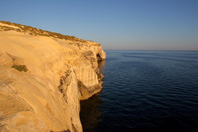 Some cliffs near sunset beyond the town of Xlendi