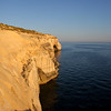 Some cliffs near sunset beyond the town of Xlendi