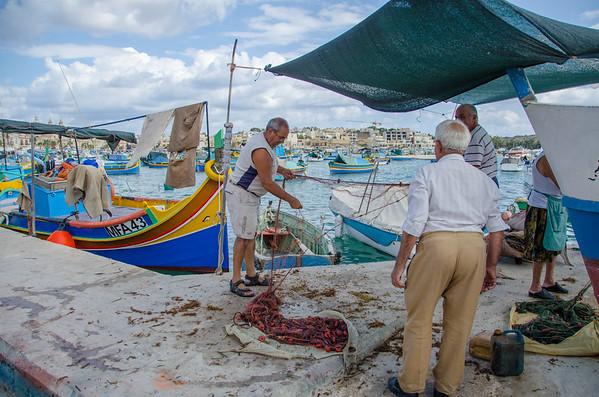 Fishermen in the Marsaxlokk Harbor, Malta