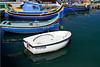 Various styles of boats in Marsaxlokk Harbor, Malta