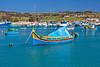 Colorful boat anchored in Marsaxlokk Harbor, Malta