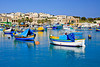 Spectacular boat scenery on a beautiful day at Marsaxlokk Harbor, Malta