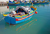 Fishing boat filled with nets ready to head out of Marsaxlokk Harbor, Malta