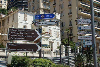 Street sign showing direction to top tourist destinations in Monaco