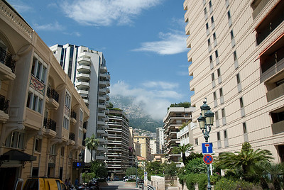 View of the moauntain cliff amidst high rise buildings in Monte Carlo, Monaco
