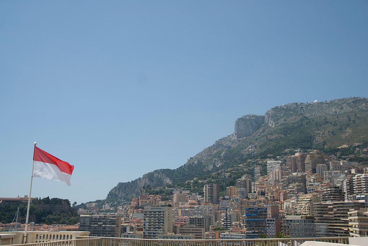 Monaco national flag with skyline as backdrop - Monaco