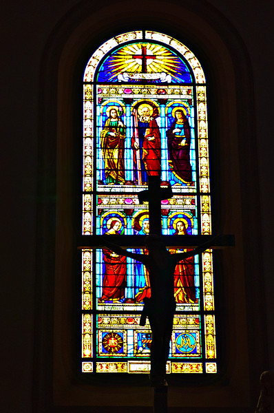 Stained glass and cruicifix in church in Vinci, Italy. Birthplace of Da Vinci.