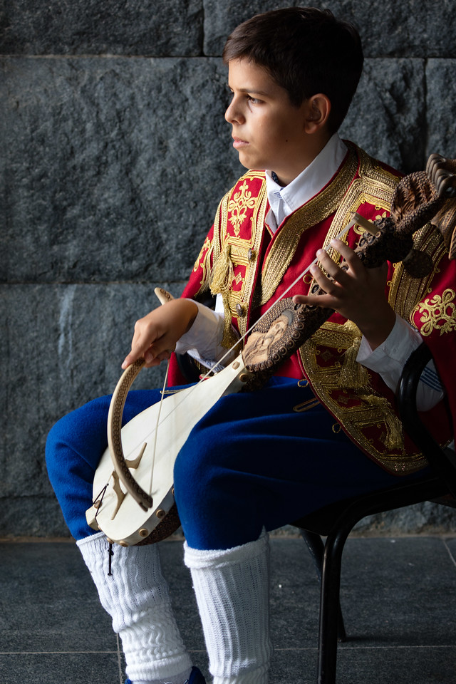 This young man is playing an ornate gusle the national instrument of Montenegro