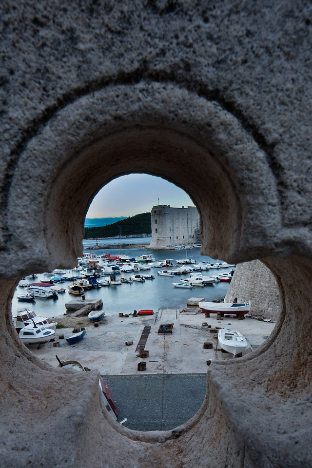 A keyhole view of the harbor from the bridge over the moat