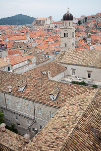 Zigzag tile roofs are the norm.  It is said the lighter colored ones are those repaired following shelling during the civil war in then Yugoslavia
