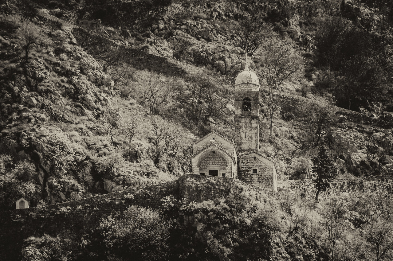 Cathedral of Saint Tryphon and stone bell tower in B&W - Kotor, Montenegro