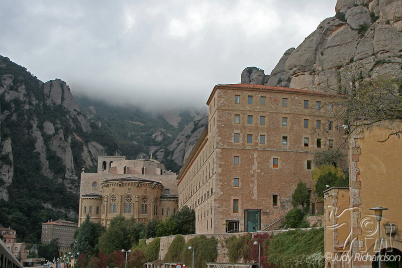 Monastery and church with peak of Montserrat in the background. Catalonia, Spain.
