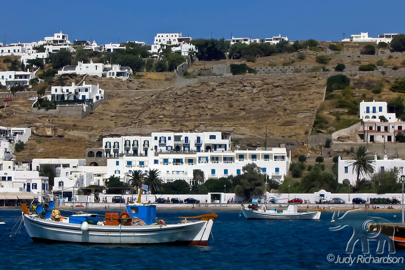 Mykonos Harbor and white houses on hillside in 2003
