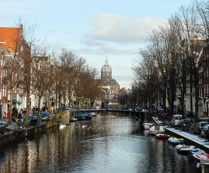 Canal surrounded by historic buildings in Amsterdam.