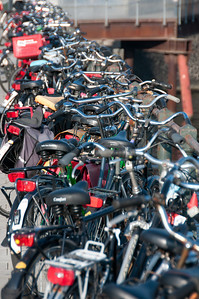 Isolated shot of parked bikes on a bridge - Amsterdam, Netherlands