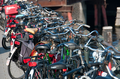 Close-up shot of parked bikes on a bridge - Amsterdam, Netherlands