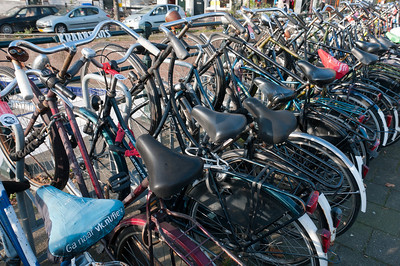 Row of bikes parked on the side street in Amsterdam, Netherlands