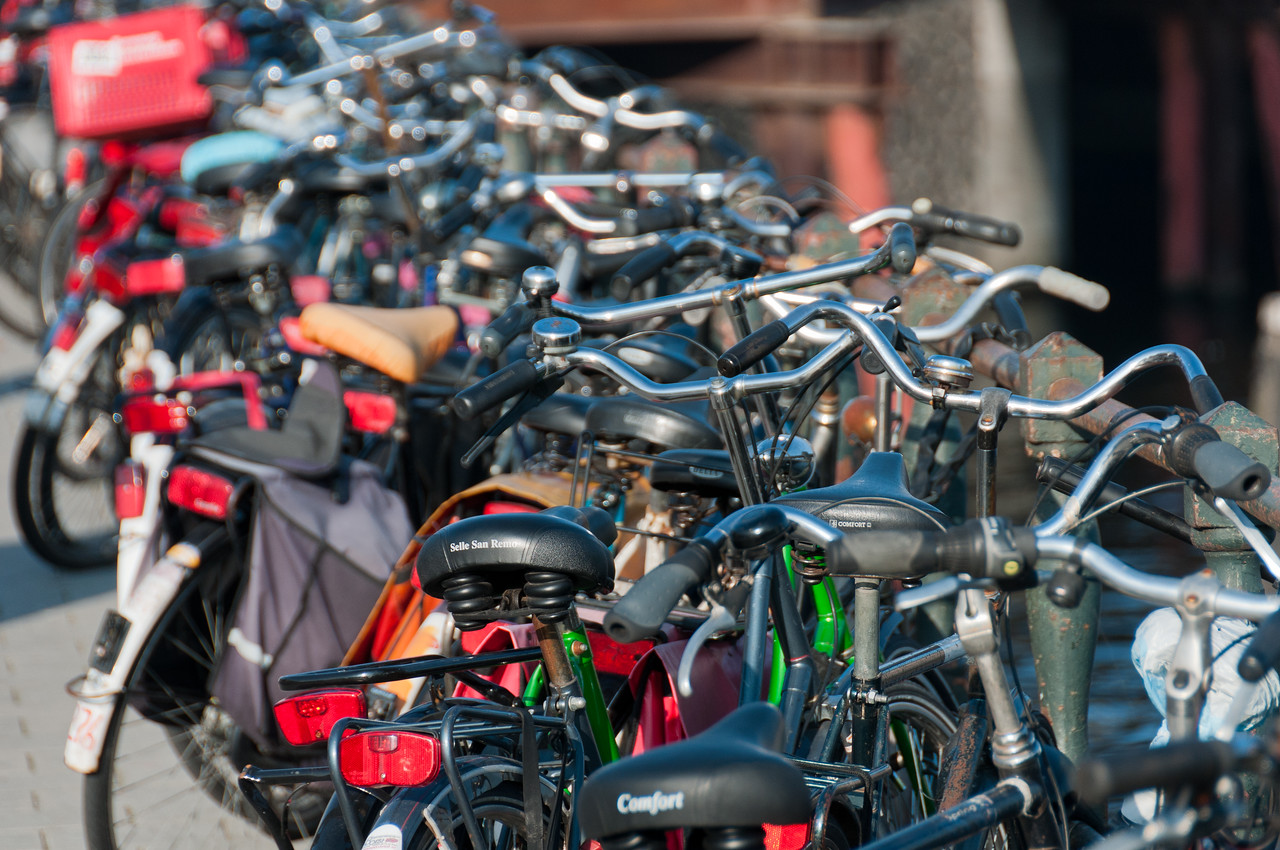 Close-up shot of parked bikes on bridge - Amsterdam, Netherlands