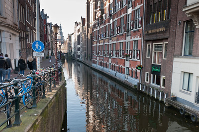 View of the canal on a small alley in Amsterdam, Netherlands