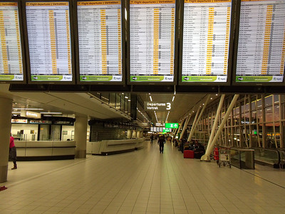 Departure board at Amsterdam Schiphol Airport.