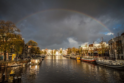 A poem of light around Amstel River.