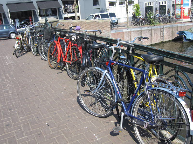 Bikes parked on a bridge over Amstel River in Amsterdam, Netherlands