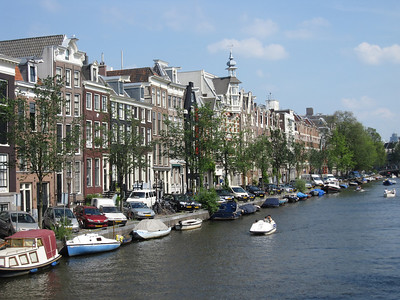 Buildings and boats along the Amstel River in Amsterdam, Netherlands
