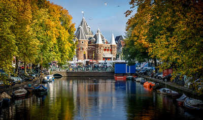 Stunning canal of Amsterdam beautified by the fall colors.
