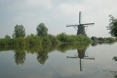 Windmill reflected on the river in Kinderdijk, Netherlands