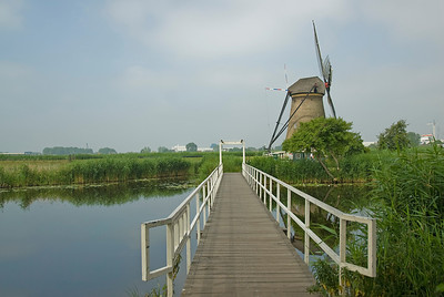 Wooden bridge leading to the windmills in Kinderdijk, Netherlands