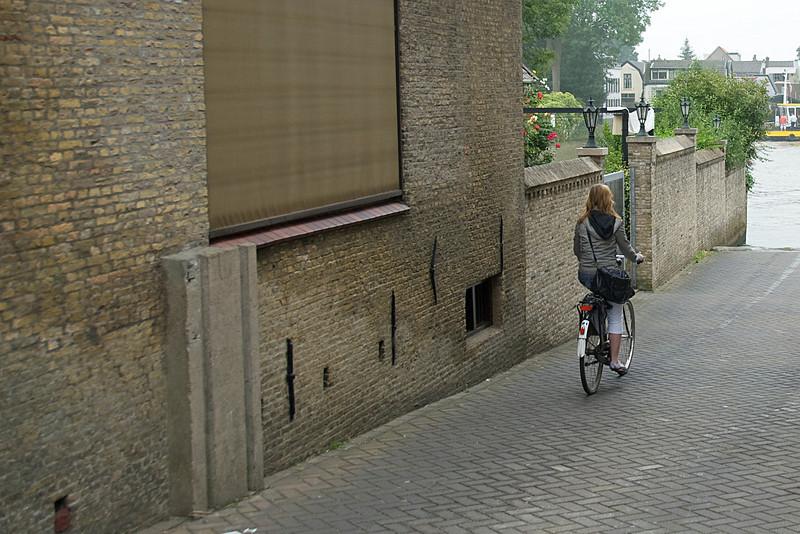 Woman on a bike in Kinderdijk, Netherlands