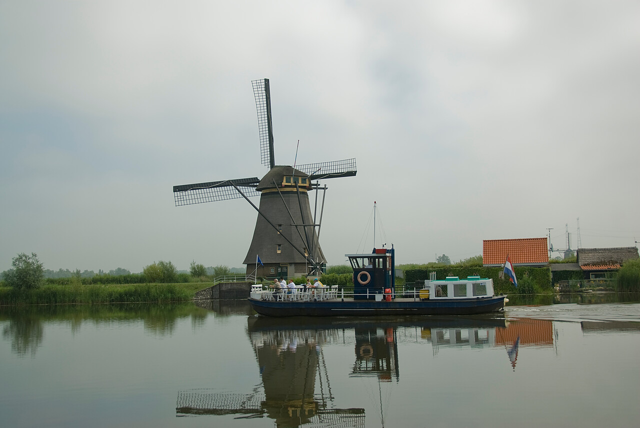 River boat cruise along the windmills in Kinderdijk, Netherlands