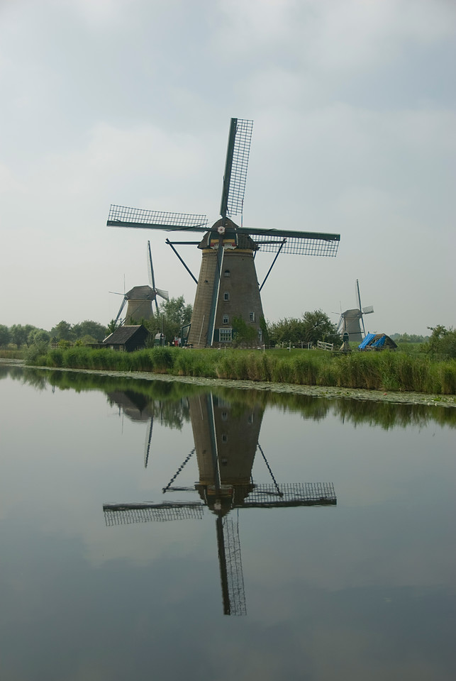 Reflection of the windmill on the river water - Kinderdijk, Netherlands