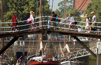 Closer shot of young tourists crossing the bridge in Netherlands