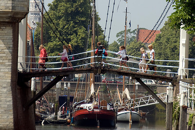 Tourists crossing a bridge in the harbor - Netherlands
