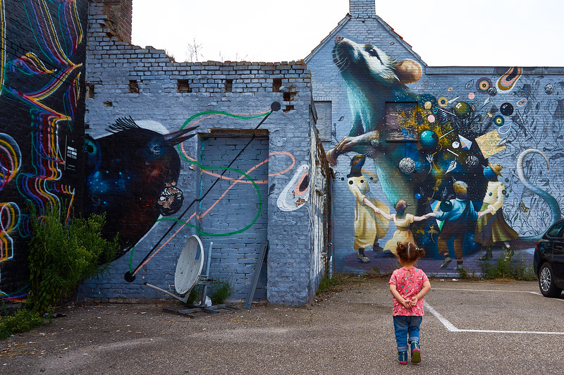 Admiring a mural collaboration by artists Rutger Termohlen, Collin van der Sluijs, and Super A in Breda, the Netherlands.