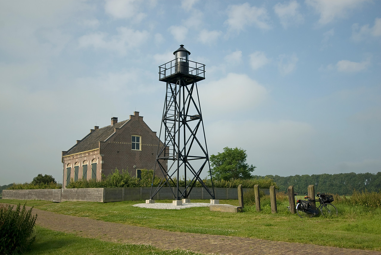 Bike, building and a water tower in Schokland, Netherlands