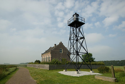 A house and water tower in Schokland, Netherlands