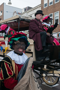 Costumed performers and carriages on parade in Utrecht, Netherlands