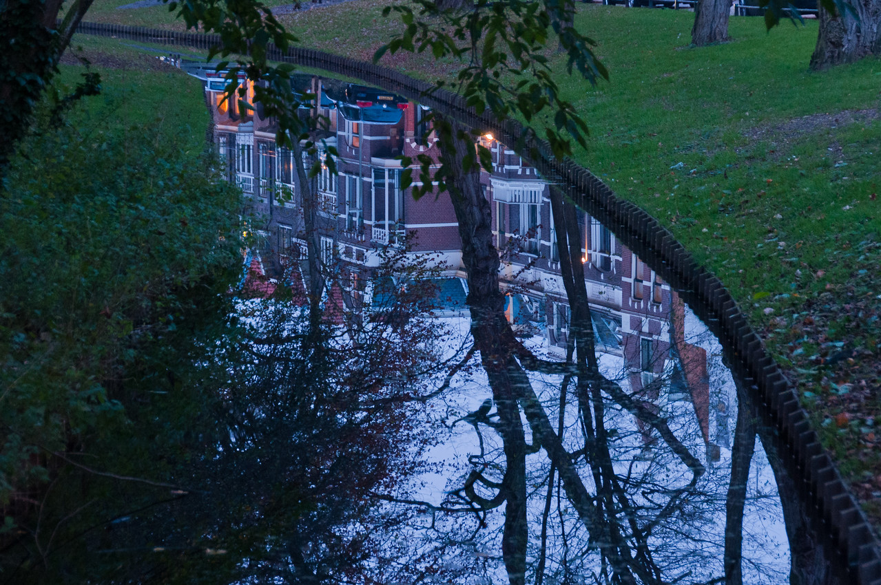 Reflection of buildings on water fountain - Utrecht, Netherlands